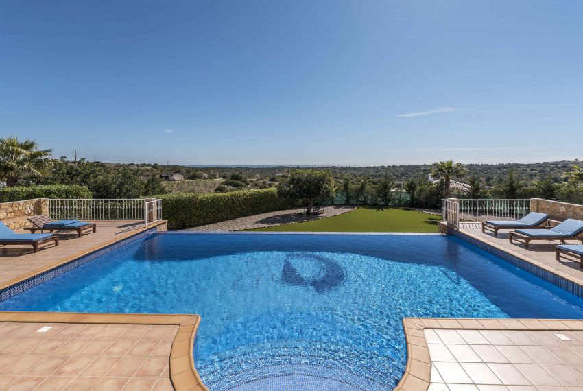 Breathtaking Sea Views Luxury 7 bedroom mansion in Porches, Enneking Real Estate swimming pool