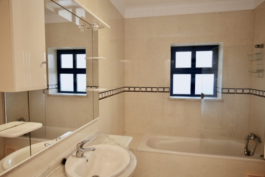 Bathroom with bath , sink,bidet,toilet,white tyles,heating towel rack